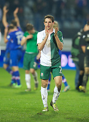 OSIJEK, CROATIA - Tuesday, October 16, 2012: Wales' Joe Allen applauds the travelling supporters after his side's 2-0 defeat by Croatia during the Brazil 2014 FIFA World Cup Qualifying Group A match at the Stadion Gradski Vrt. (Pic by David Rawcliffe/Propaganda)