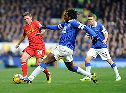 Everton's Romelu Lukaku challenges Liverpool's Joe Allen - Photo mandatory by-line: Dougie Allward/JMP - Tel: Mobile: 07966 386802 23/11/2013 - SPORT - Football - Liverpool - Merseyside derby - Goodison Park - Everton v Liverpool - Barclays Premier League