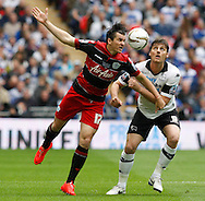 Chris Martin of Derby County (left) and Joey Barton of Queens Park Rangers during the Sky Bet Championship Play Off final at Wembley Stadium, London<br /> Picture by Andrew Tobin/Focus Images Ltd +44 7710 761829<br /> 24/05/2014