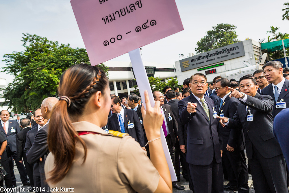21 AUGUST 2014 - BANGKOK, THAILAND:  Admiral WALLOP KERDPHOL (center, green tie), of the Royal Thai Navy and a member of the National Legislative Assembly (NLA), along with other members of the NLA, line up for their official group photo before meeting to select a new Prime Minister. The NLA was hand selected by the Thai junta, formally called the National Council for Peace and Order (NCPO), and is supposed to guide Thailand back to civilian rule after a military coup overthrew the elected government in May. The NLA unanimously selected General Prayuth Chan-ocha, commander of the Thai Armed Forces and leader of the coup in May that deposed the elected civilian government, as Prime Minister. Prayuth is Thailand's 29th Prime Minister since the 1932 coup that created Thailand's constitutional monarchy.        PHOTO BY JACK KURTZ
