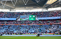 A general view of members of HMS Collingwood on the pitch prior to the beginning of the Carabao Cup Final at Wembley Stadium, London.