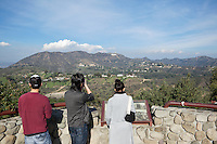 Tourists Sightseeing the Hollywood Sign at Mulholland Drive Scenic Overlook, Los Angeles, California