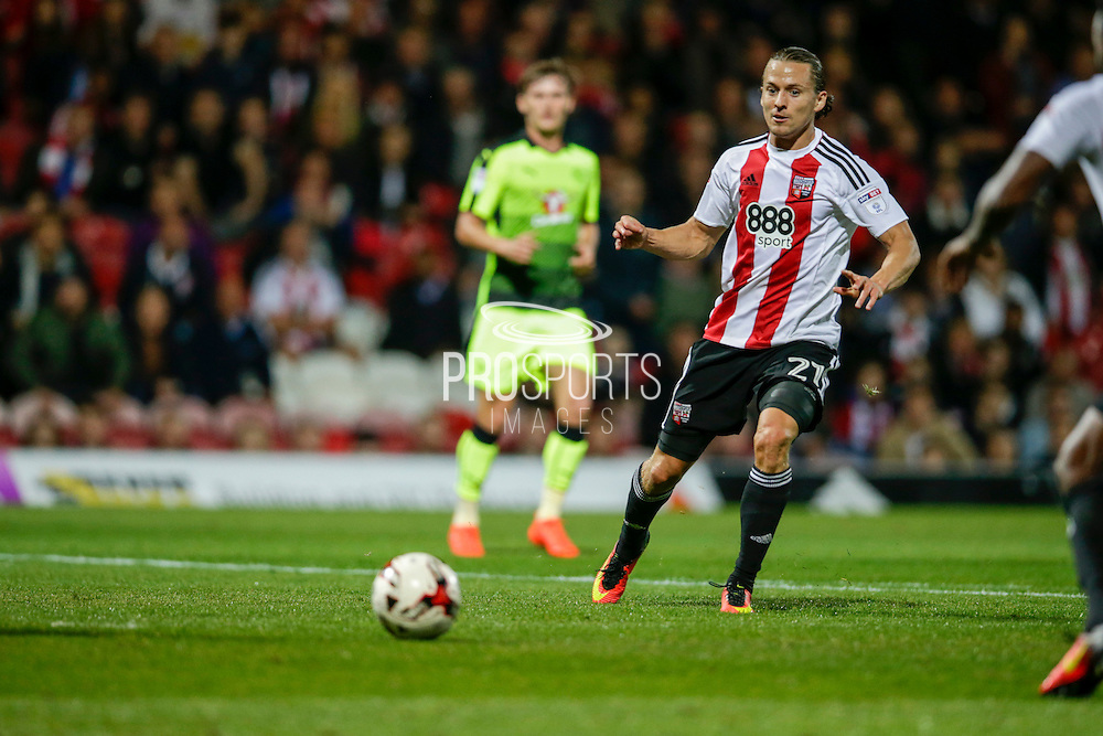 Lasse Vibe passing during the EFL Sky Bet Championship match between Brentford and Reading at Griffin Park, London, England on 27 September 2016. Photo by Jarrod Moore.