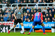 Ki Sung-Yueng (#4) of Newcastle United on the ball, opposed by James McArthur (#18) of Crystal Palace during the Premier League match between Newcastle United and Crystal Palace at St. James's Park, Newcastle, England on 6 April 2019.