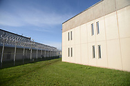 Exterior fences with barbed wire designed to keep prisoners inside is seen as media members tour the newest prison in Pennsylvania Friday, September 01, 2017 at State Correction Institution Phoenix in Skippack, Pennsylvania. The facility is inching closer to opening, two years late, to replace Graterford Prison at a cost of $400 million. (Photo by William Thomas Cain/CAIN IMAGES)