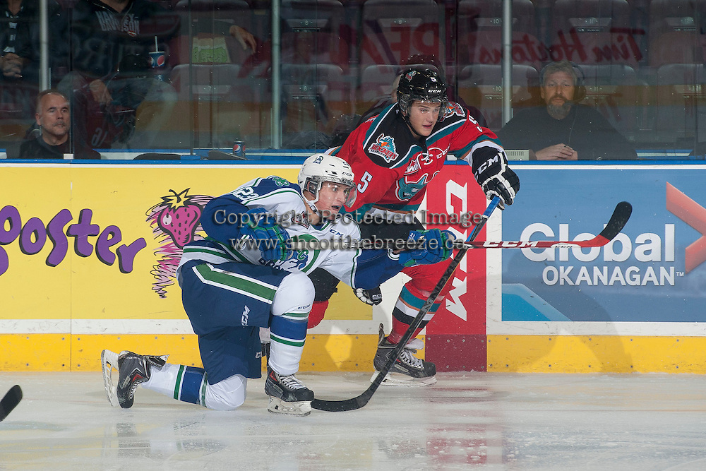 KELOWNA, CANADA - OCTOBER 7: Dalton Yorke #5 of Kelowna Rockets checks Dakota Odgers #23 of Swift Current Broncos during the first period on October 7, 2014 at Prospera Place in Kelowna, British Columbia, Canada.  (Photo by Marissa Baecker/Getty Images)  *** Local Caption *** Dakota Odgers; Dalton Yorke;