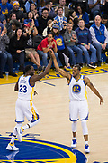 Golden State Warriors forward Draymond Green (23) and forward Andre Iguodala (9) celebrate against the Houston Rockets at Oracle Arena in Oakland, Calif., on March 31, 2017. (Stan Olszewski/Special to S.F. Examiner)