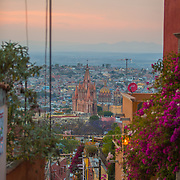A winding hillside street in San Miguel de Allende offers a view of  La Parroquia rising up from the landscape. La Parroquia de San Miguel Arcángel, the current parish church of San Miguel, is unique in Mexico and the emblem of the town.The church was built in the 17th century with a traditional Mexican façade. The current Gothic façade was constructed in 1880 by Zeferino Gutierrez, who was an indigenous bricklayer and self-taught architect.