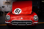 A red vintage corvette on display in the paddock at the Rolex Monterey Motorsports Reunion during Monterey Car Week