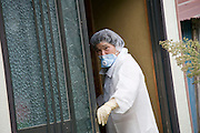 A woman, who asked not to be identified, enters her home after she and other residents were allowed briefly to collect valuables and other belongings from their homes inside the nuclear exclusion zone in Okuma, Fukushima Prefecture, Japan on Aug. 31 2011. Robert Gilhooly Photo