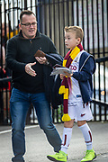 A young Bradford City supporter with his dad arriving at the Utilita Energy Stadium before the EFL Sky Bet League 2 match between Bradford City and Northampton Town at the Utilita Energy Stadium, Bradford, England on 7 September 2019.