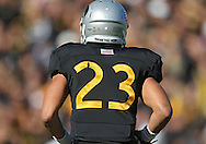 "November 10 2012: The back of Iowa Hawkeyes wide receiver Jordan Cotton's (23) helmet which reads ""Thank You, Vets"" for Veterans Day during the NCAA football game between the Purdue Boilermakers and the Iowa Hawkeyes at Kinnick Stadium in Iowa City, Iowa on Saturday, November 10, 2012. Purdue defeated Iowa 27-24."