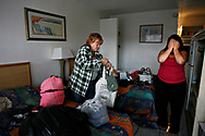 MELISSA LYTTLE   |   Times<br /> SP_345156_LYTT_MOTEL_1 (November 22, 2011, St. Petersburg, FL) Laurie Hathaway, 29, right, was three days behind on her payment for room 88 at the Mosley Motel and asked to leave. Just when she thought it couldn't get any worse, an exasperated Hathaway covered her face with her hands and sighs. Her mom, Karen Dall, left, had just returned home from the hospital after being Baker Acted when she learned that they no longer had a place to live. Dall started packing her own bags, saying &quot;she'd just find a shelter or a friend or sleep on the streets&quot; because Hathaway had called her aunt for help and a free place to crash with her son for the weekend, and her mom knew she wasn't welcome there.   [MELISSA LYTTLE, Times]