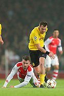 Aaron Ramsey of Arsenal and Kevin Grobkreutz of Borussia Dortmund battle for possession during the UEFA Champions League match at the Emirates Stadium, London<br /> Picture by Richard Calver/Focus Images Ltd +447792 981244<br /> 26/11/2014