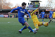 AFC Wimbledon midfielder Jake Reeves (8) sends a cross in during the EFL Sky Bet League 1 match between AFC Wimbledon and Millwall at the Cherry Red Records Stadium, Kingston, England on 2 January 2017. Photo by Stuart Butcher.