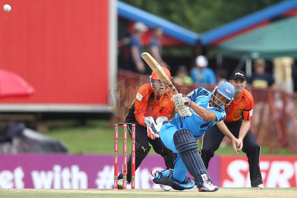 Jacques Rudolph of the Titans slog sweeps a delivery to the boundary during match 1 of the Karbonn Smart CLT20 South Africa between The Titans and The Perth Scorchers held at Supersport Park Stadium in Centurion, South Africa on the 13th October 2012..Photo by Shaun Roy/SPORTZPICS/CLT20