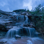 A flash flood turns an amphitheater into a waterfall in Moab, Utah.