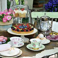 Vintage garden: Tabletop set for tea inside glass shed