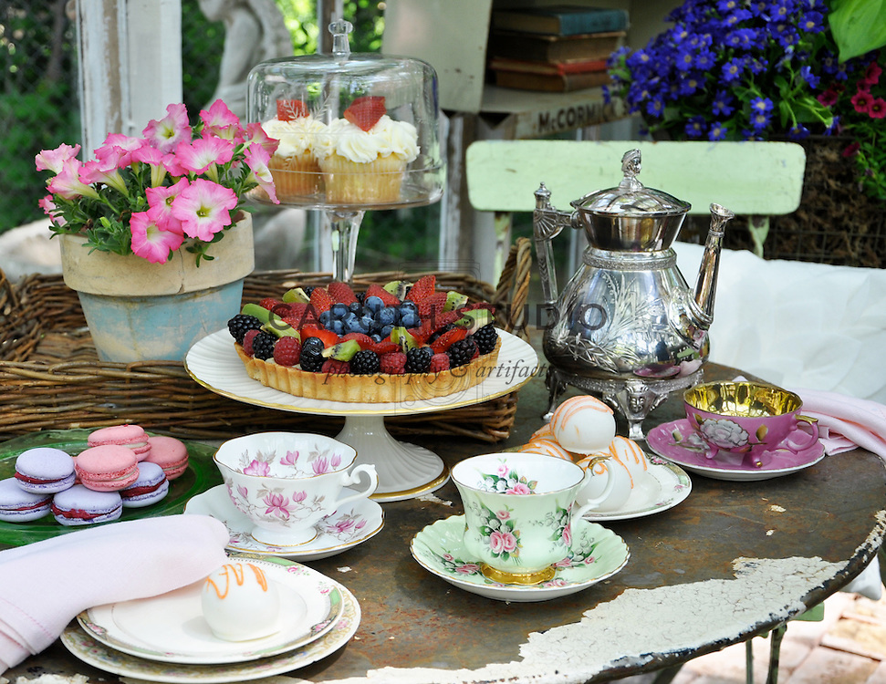Vintage garden: Tabletop set for tea inside glass shed