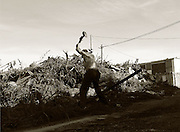 Bratislava, Slovakia ( 16/08/2006).Jano 66 swings a sledgehammer to break the concrete off an old steel girder. Jano makes his living recycling metal for money..**Heavy Metal Lifestyle