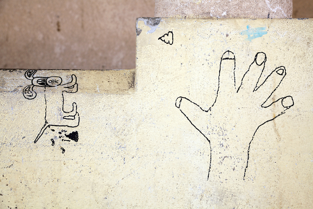 graffiti line drawing of hand and dog