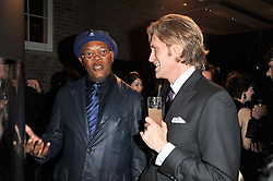 Left to right, SAMUEL L JACKSON and Creative Director of Asprey BRUCE HOEKSEMA at the BAFTA Nominees party 2011 held at Asprey, 167 New Bond Street, London on 12th February 2011.