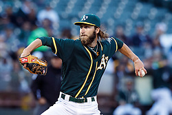 OAKLAND, CA - JULY 19:  Dillon Overton #47 of the Oakland Athletics pitches against the Houston Astros during the first inning at the Oakland Coliseum on July 19, 2016 in Oakland, California. (Photo by Jason O. Watson/Getty Images) *** Local Caption *** Dillon Overton