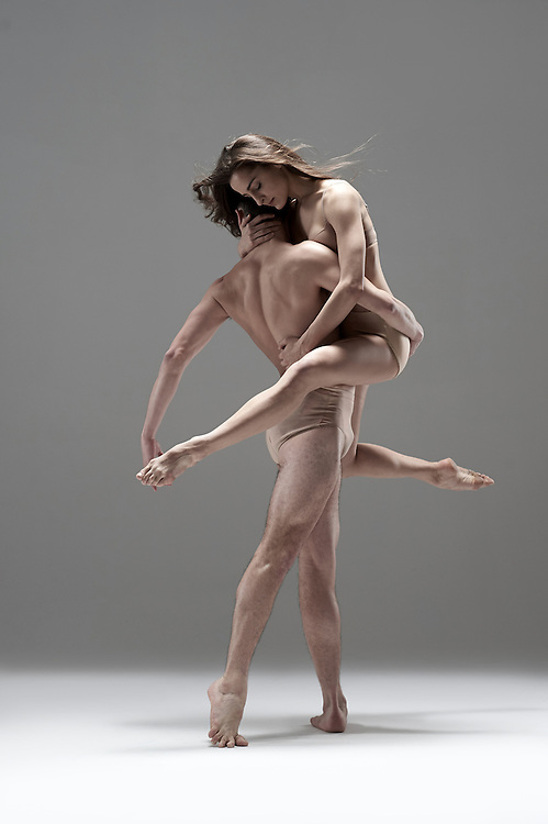 Pax de duex of two contemporary ballet dancers from Ballet Hispanico in the nude. Shot in the studio against a grey background. Photographed by dance photographer, Rachel Neville.