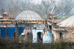 ©Licensed to London News Pictures. 14/04/2016 London UK. A house built illegally by Rob Fidler of Redhill Surrey being demolished further. Reigate and Banstead Council said it has to be down before June after is was constructed without planning permission and then hidden from view. Photo credit: Presspics/LNP