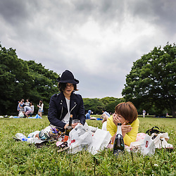 Couple enjoying the weekend at Yoyogi park on a cloudy day, Tokyo, Japan, Asia