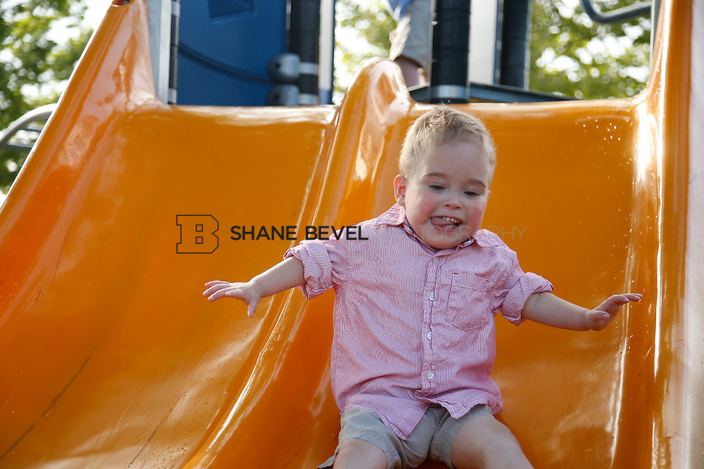 5/28/15 6:07:34 PM -- Miracle Miles and his family pose for portraits and play at the QuikTrip park for the 2015 Saint Francis Health System advertising campaign. <br /> <br /> Photo by Shane Bevel
