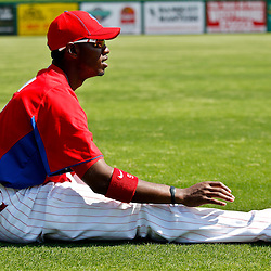 February 24, 2011; Clearwater, FL, USA; Philadelphia Phillies right fielder Domonic Brown (9) stretches prior to a spring training exhibition game against the Florida State Seminoles at Bright House Networks Field. The Phillies defeated the Seminoles 8-0. Mandatory Credit: Derick E. Hingle