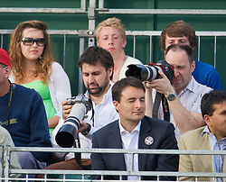 LONDON, ENGLAND - Wednesday, June 24, 2009: Spectators take photographs during a Ladies' Singles 2nd Round match on day three of the Wimbledon Lawn Tennis Championships at the All England Lawn Tennis and Croquet Club. (Pic by David Rawcliffe/Propaganda)