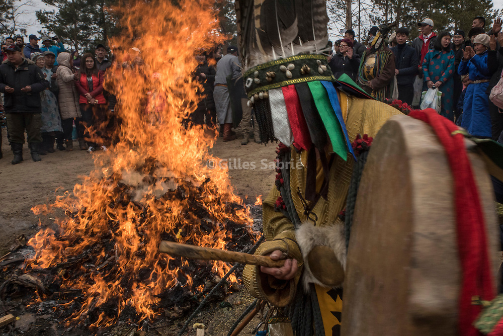 S&uuml;khbaatar, MONGOLIA, April 4th 2017<br /> A Shaman beating his drum in trance around a bone fire at Eej Mod (the Mother Tree) during a celebration of spring.<br /> Gilles Sabri&eacute; for 1843