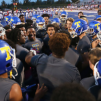 Adam Robison | BUY AT PHOTOS.DJOURNAL.COM<br /> Tupelo players get pumped prior to kickoff of the South Panola game Friday night in Tupelo.
