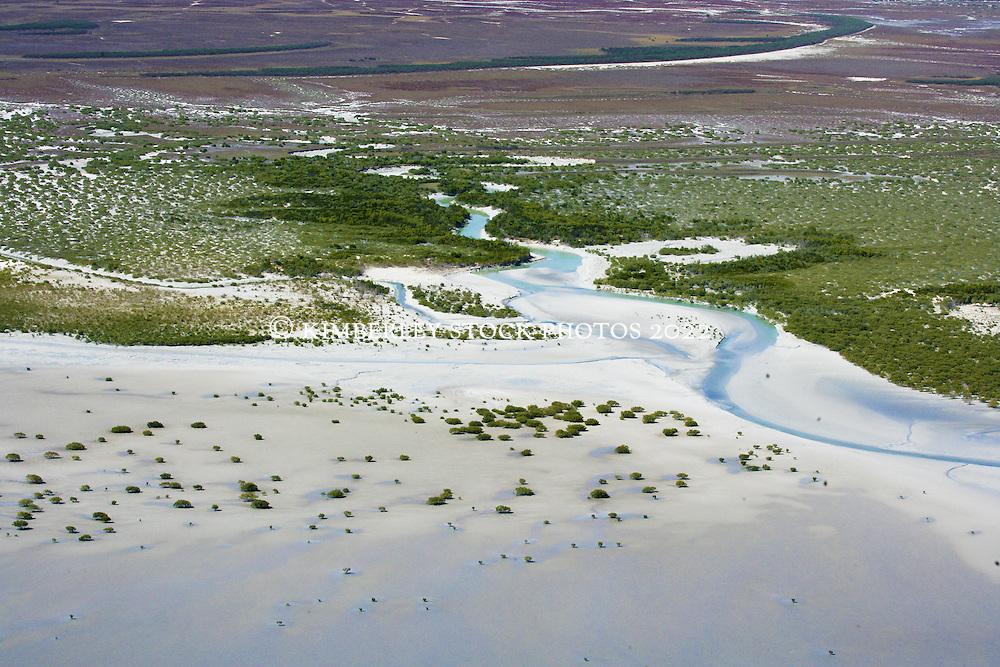 Mangroves line a narrow channel where water empties into Roebuck Bay.  Vast mud flats are exposed at low tides.