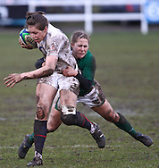 Esher, Surrey, Sunday February 28th 2010: England's Emily Scarratt is tackled by Shannon Houston of Ireland during the Ladies Six Nations match between England and Ireland at Esher Rugby Club. (Pic by Andrew Tobin/Focus Images)