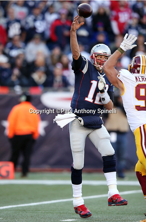 New England Patriots quarterback Tom Brady (12) throws a pass while being pressured by Washington Redskins outside linebacker Ryan Kerrigan (91) during the 2015 week 9 regular season NFL football game against the Washington Redskins on Sunday, Nov. 8, 2015 in Foxborough, Mass. The Patriots won the game 27-10. (©Paul Anthony Spinelli)
