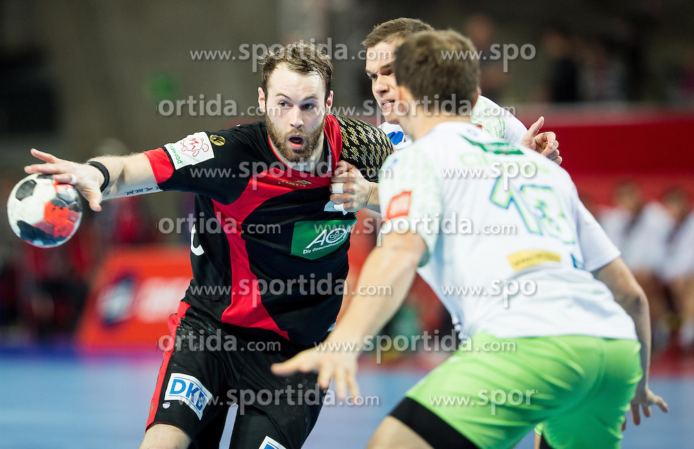 Steffen Faeth of Germany vs Vid Poteko of Slovenia during handball match between National teams of Germany and Slovenia on Day 6 in Preliminary Round of Men's EHF EURO 2016, on January 20, 2016 in Centennial Hall, Wroclaw, Poland. Photo by Vid Ponikvar / Sportida
