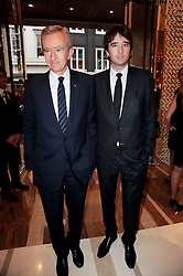 BERNARD ARNAUD the founder, chairman, and CEO of LVMH and his son ANTOINE ARNAUD at a party to celebrate the opening of the Louis Vuitton Bond Street Maison, New Bond Street, London on 25th May 2010.