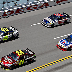 April 17, 2011; Talladega, AL, USA; NASCAR Sprint Cup Series driver Jimmie Johnson (48), \s24, Dale Earnhardt Jr. (88) and Mark Martin (5) take turn four during the Aarons 499 at Talladega Superspeedway.   Mandatory Credit: Derick E. Hingle