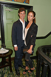 QUENTIN JONES and GEORGE NORTHCOTT at a Bastille Day Cocktail Party at L'Escargot, 48 Greek Street, London on 14th July 2014.