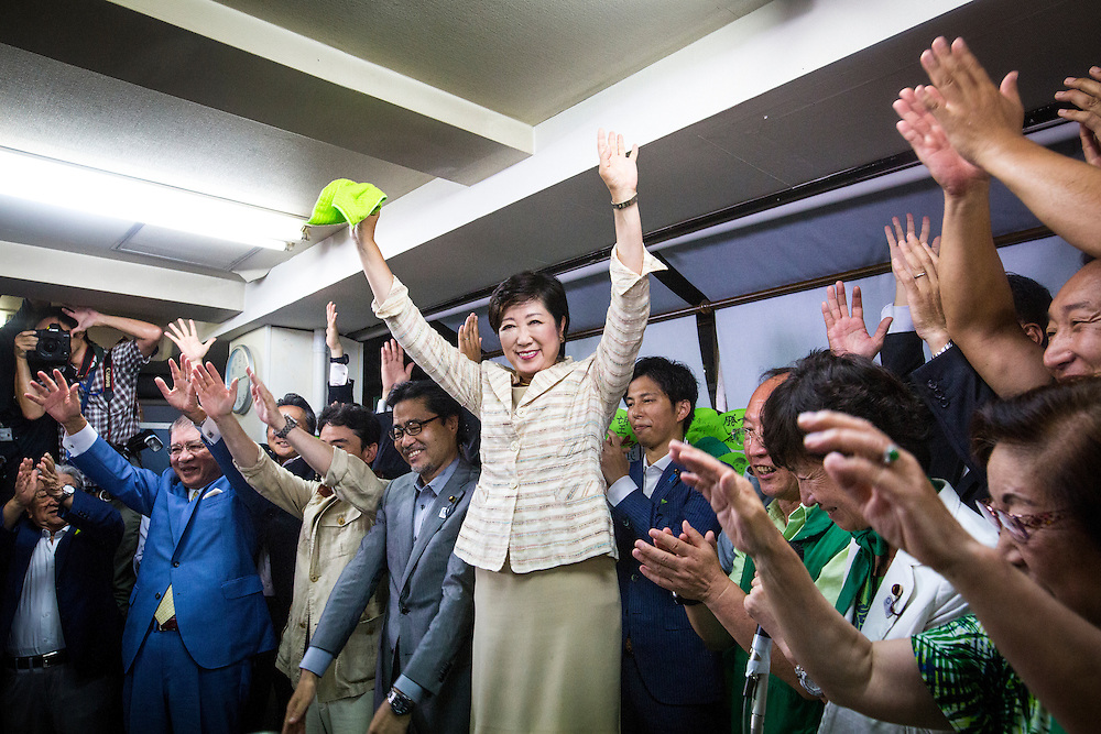 TOKYO, JAPAN - JULY 31 : Yuriko Koike, newly elected governor of Tokyo, center, and her party celebrates after she speaks in a news conference, during winning the Tokyo gubernatorial election at her office in Tokyo, Japan, on Sunday, July 31, 2016. Yuriko Koike a Liberal Democratic Party lawmaker and former defense minister is the first women to be elected as a Governor of Tokyo. (Photo: Richard Atrero de Guzman/NURPhoto)