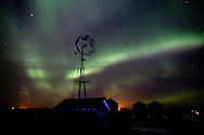 Photo Randy Vanderveen.near Sexsmith, Alberta.06/04/10.The northern lights (aurora borealis) colour the Peace Country sky behind a silhouetted windmill along Highwat  59 north of Sexsmith very early Tuesday morning. This past week has been a good one to view the night-time displays.