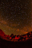 The finger canyons of the Kolob with the Milky Way in the starry night sky overhead, Zion National Park, Utah, USA.