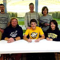 Falconer's Cooper Miller along with Father Doug Miller, and mother Annette Miller with Coach Jackson, Tom Anderson and Coach Tordella  signs a letter of intent to attend Allegeheny College  at the lakewood YMCA 4-7-2016 photo by Mark L. Anderson