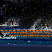 Swimmers in the Women's 100m backstroke heats compete in the early morning Roman light at the World Swimming Championships in Rome on Monday, July 28, 2009. Photo Tim Clayton.