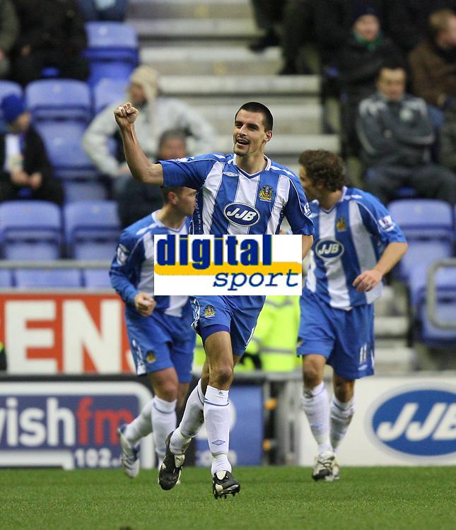 Photo: Paul Greenwood/Sportsbeat Images.<br />Wigan Athletic v Blackburn Rovers. The FA Barclays Premiership. 15/12/2007.<br />Wigan's Paul Scharner celebrates scoring