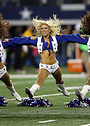 The Dallas Cowboys cheerleaders do a split during a dance routine at the NFL week 6 football game against the Washington Redskins on Sunday, Oct. 13, 2013 in Arlington, Texas. The Cowboys won the game 31-16. ©Paul Anthony Spinelli
