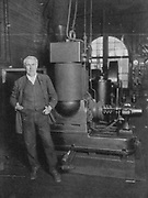 Thomas Alva Edison (1847-1931) American inventor, with his first dynamo for producing electric light.